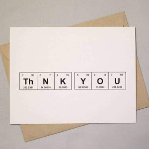 "A white cad with a black text: ""THNK YOU"" in a periodic table design. Comes with a brown envelope."