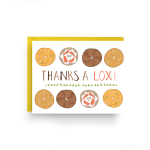 "A box set of 6 white cards with text: ""THANKS A LOX!"" and illustration of eight different kinds of bagels. Comes with a yellow envelope."