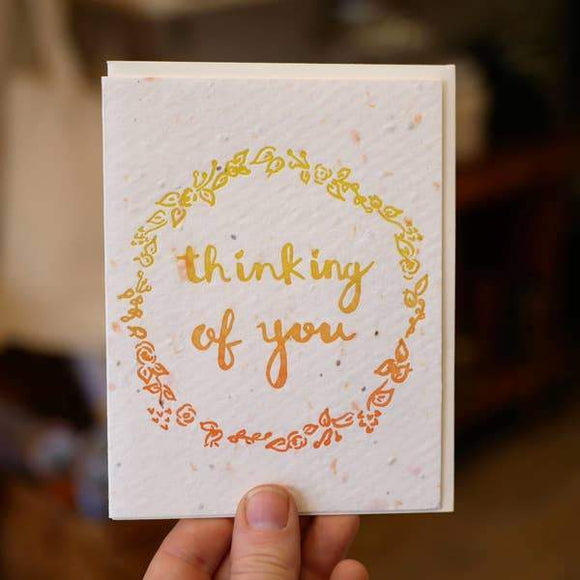 A white card with a yellow/orange ombre text: