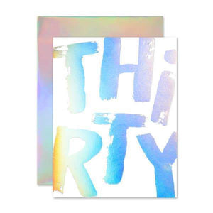 "A white card with a holography text: ""THIRTY"""