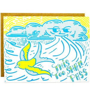 "A card with an illustration of a cloud blowing a wind and a yellow bird flying away with a blue text: ""THIS TOO SHALL PASS."""