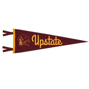 "A maroon colored triangular pennant with yellow text: ""UPSTATE"" and an illustration of a mountain."