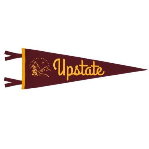 A maroon colored triangular pennant with yellow text: