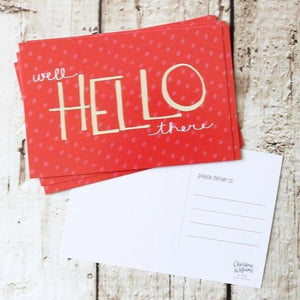 "A red post card with polkadot background and a white text: ""WELL HELLO THERE."""