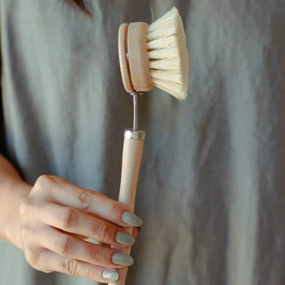 A wooden dish brush.