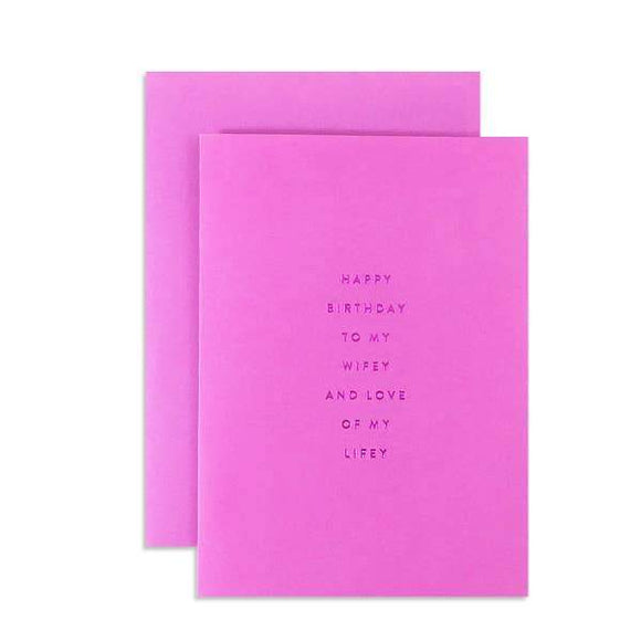 A pink card with a black text: