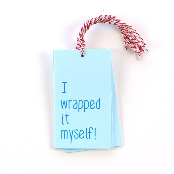 A blue gift tag with red/white strings and a blue text: