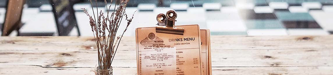 Good example of menu design on a drinks menu in the window of a restaurant