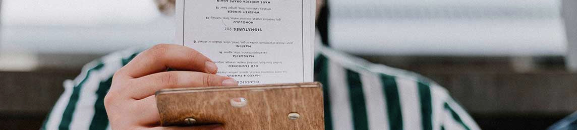 Customer reading a well designed menu