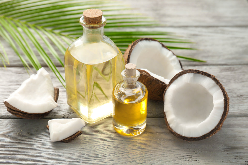Coconuts and oil bottles