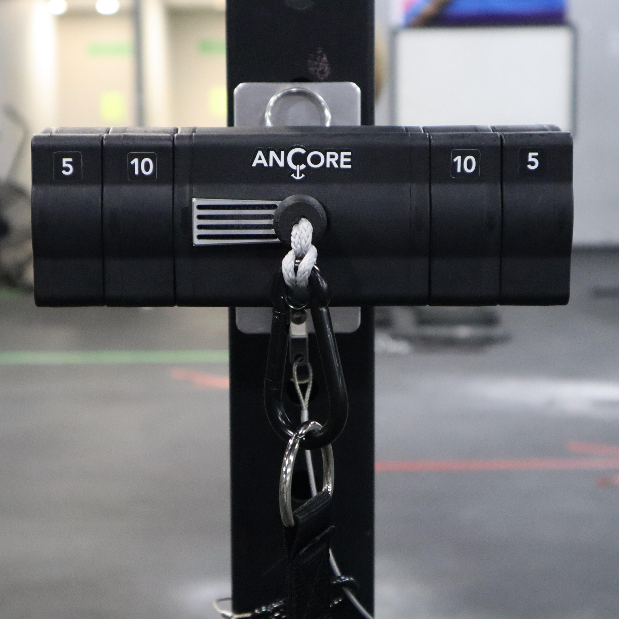 the ancore trainer and ancore rack mount being used on a squat rack