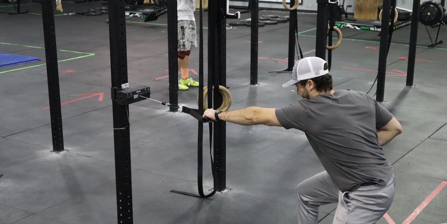 an athlete using the ancore trainer for explosive rows