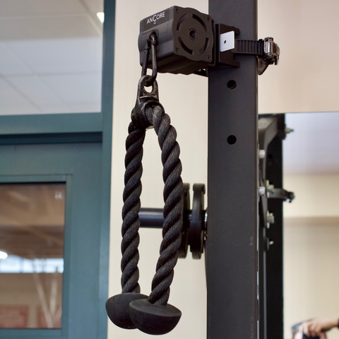 an ANCORE Tricep Rope attached an ANCORE Trainer at a gym