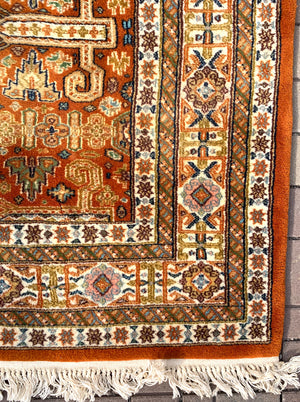 Vintage 7' x 10' Knotted Rug in Rust