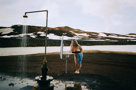 Stephanie Le in the outdoor shower in Iceland