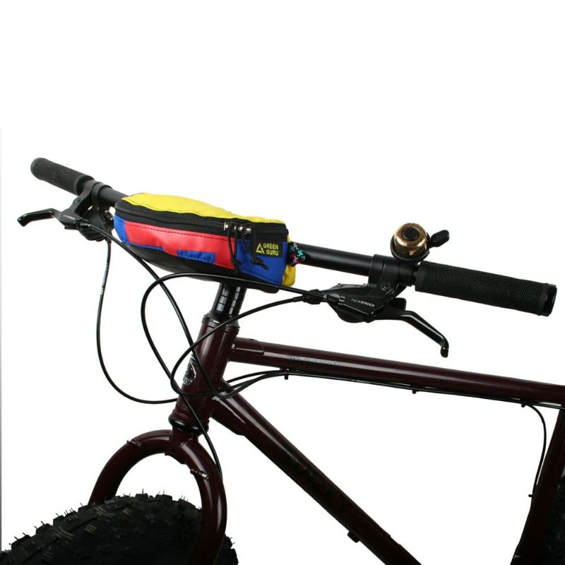 Hipster hip and handlebar pack mounted onto a mountain bike's handlebars