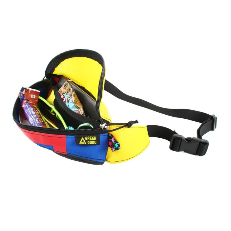 Side view of the hipster hip and handlebar pack with the zippered compartment open and containing two energy bars, a pair of sunglasses and other things
