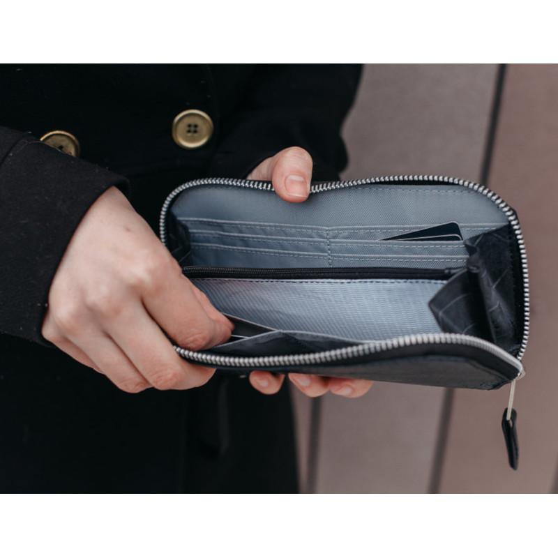 Alchemy Goods Fauntleroy clutch and passport wallet in action