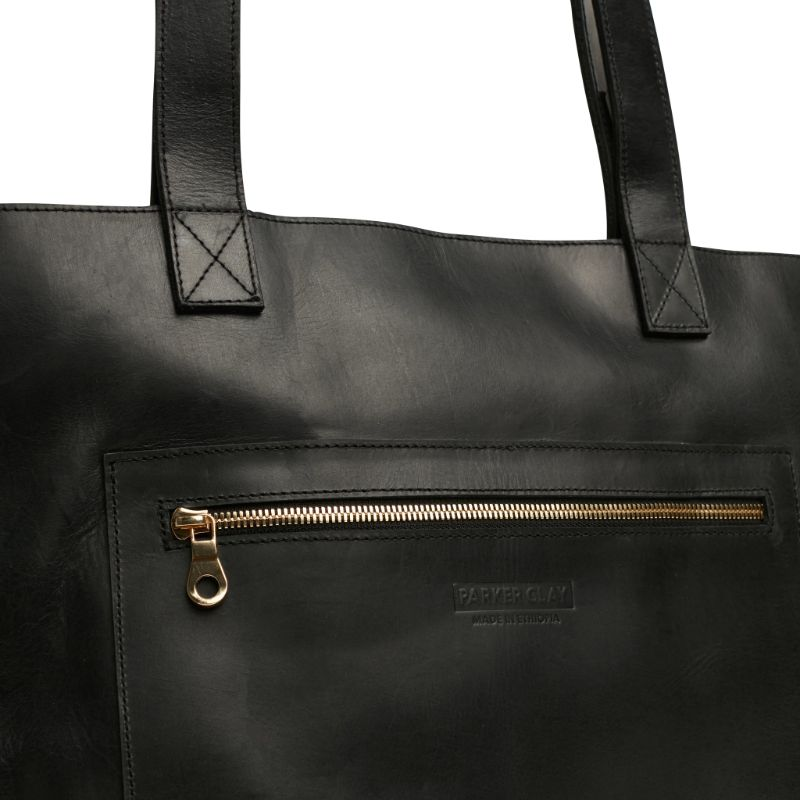 Detailed view of the black Entoto Zip Tote