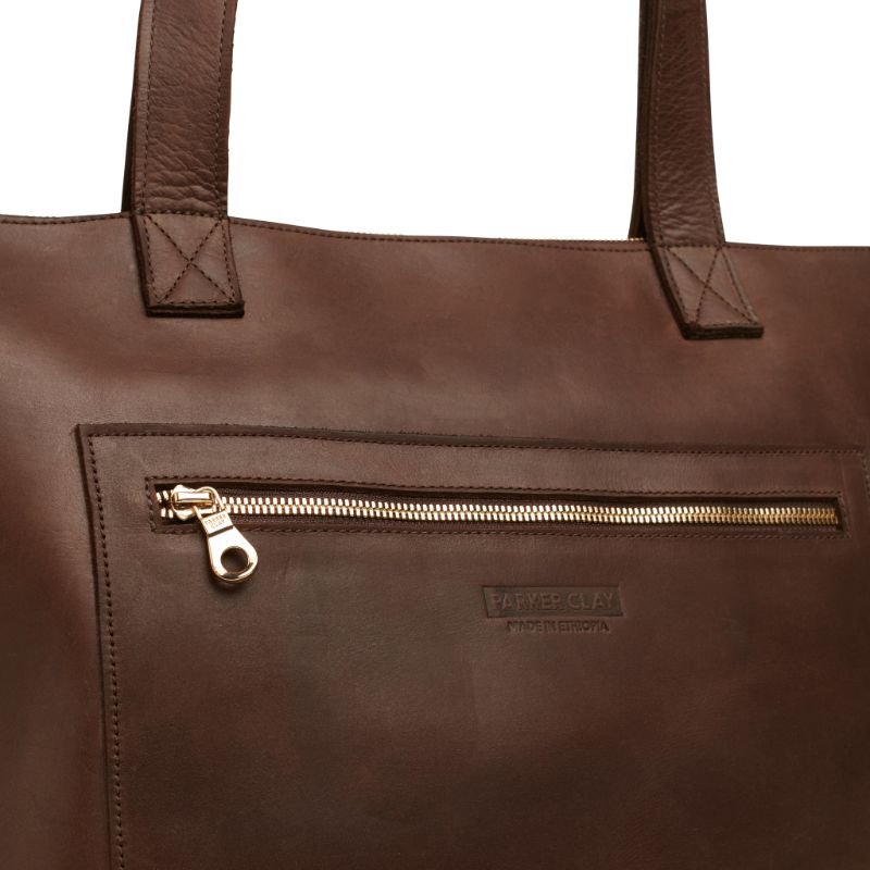 Detailed view of the dark brown Entoto Zip Tote