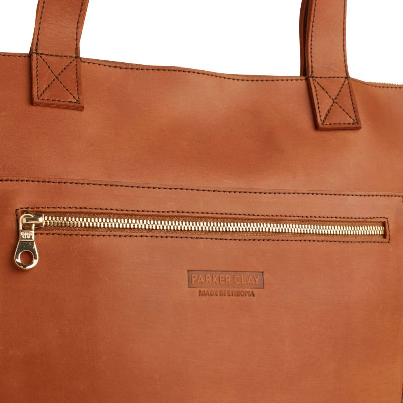 Detailed view of the rust brown Entoto Zip Tote