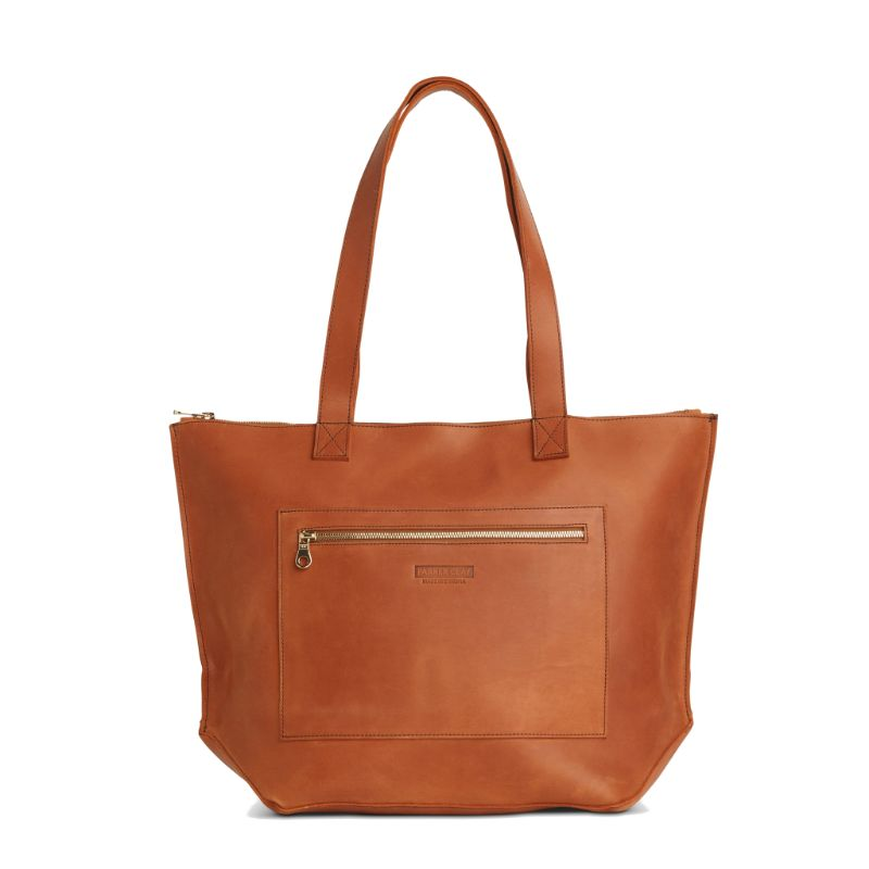 Front view of the rust brown Entoto Zip Tote