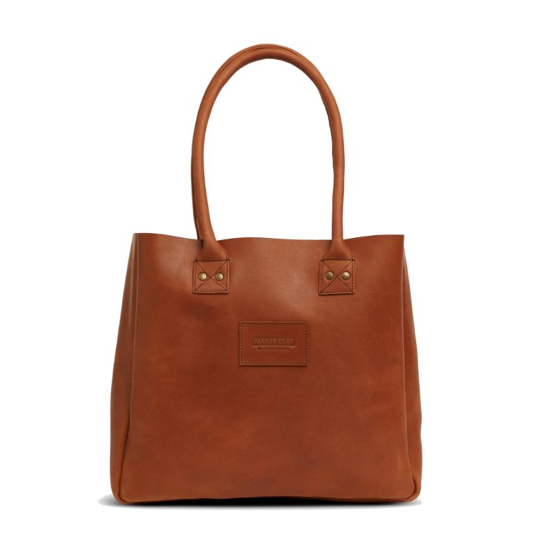 Front view of the rust brown Merkato Signature Tote