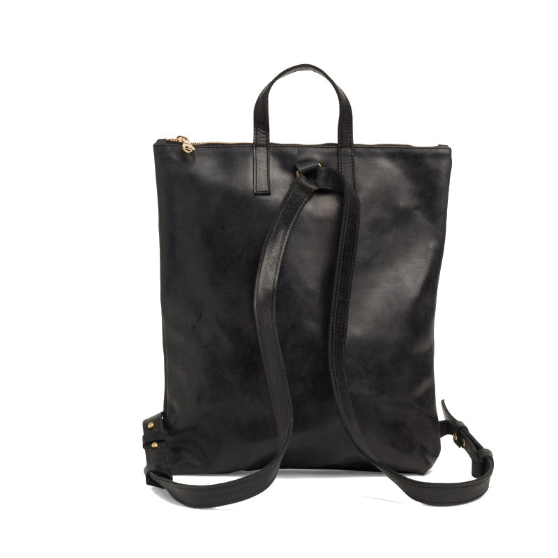 Rear view of the black Miramar Leather Backpack with straps shown