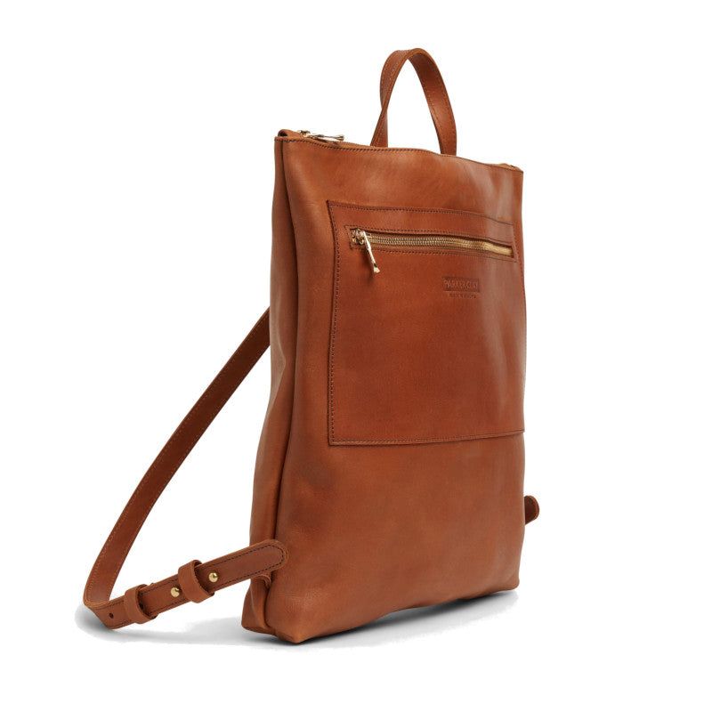Angle view of the rust brown Miramar Leather Backpack