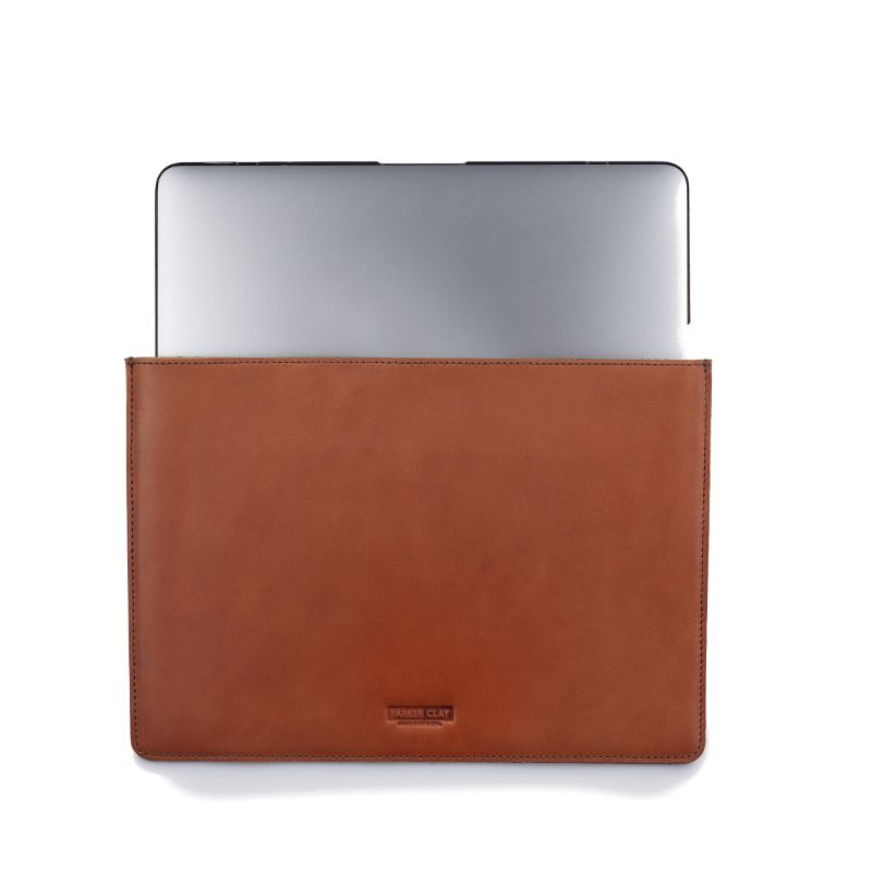 Front view of the rust brown Presidio Laptop Sleeve - 13 Inch with laptop