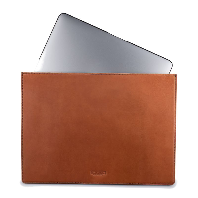 Front view of the rust brown Presidio Laptop Sleeve - 13 Inch with angled laptop