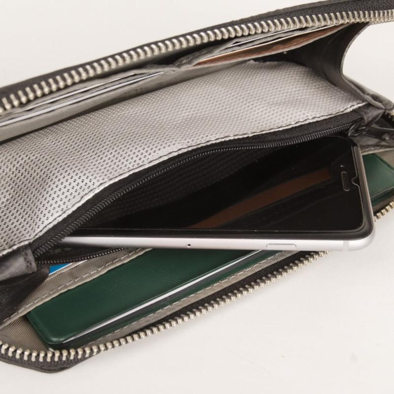 Alchemy Goods Fauntleroy clutch and passport wallet open with phone in it side view