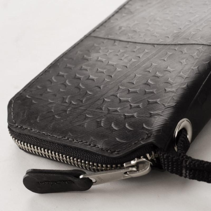 Alchemy Goods Fauntleroy clutch and passport wallet side view with close up on pull handle
