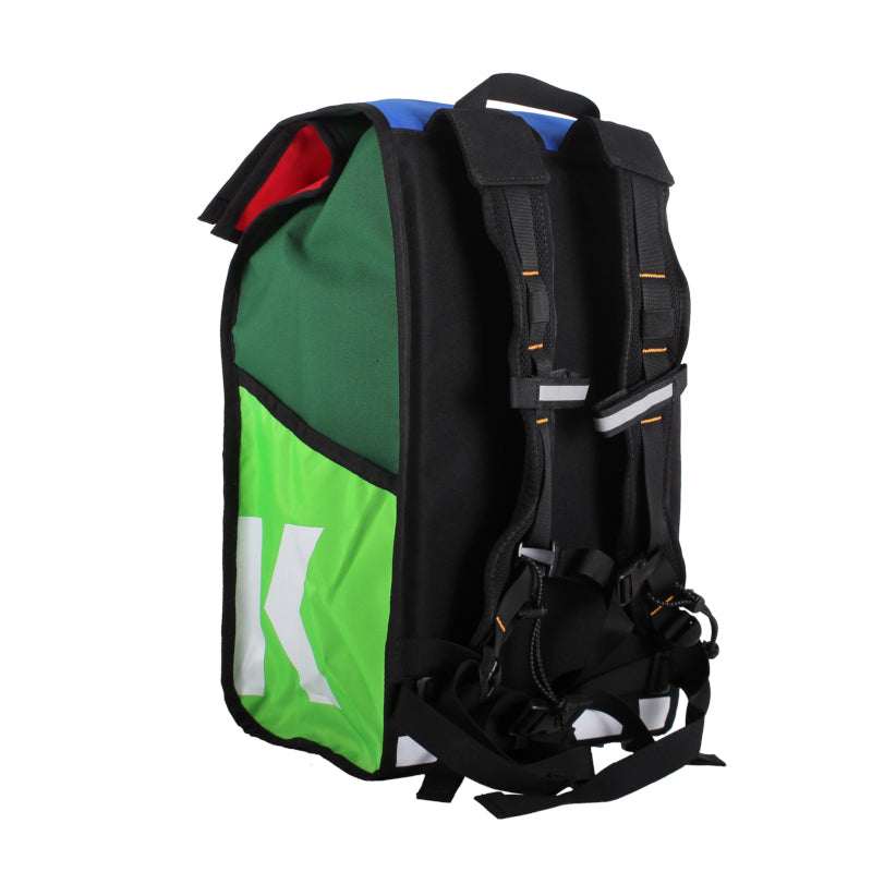 Left side view of roll top backpack showing straps and reflective accents