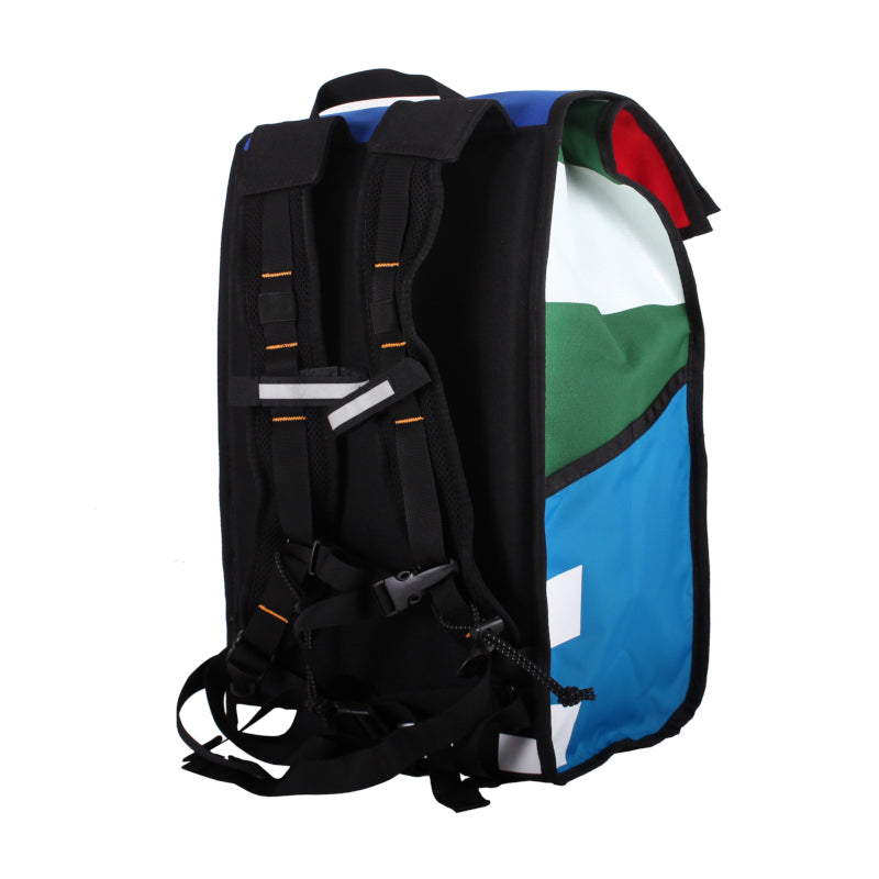 Right side view of roll top backpack showing straps and reflective accents
