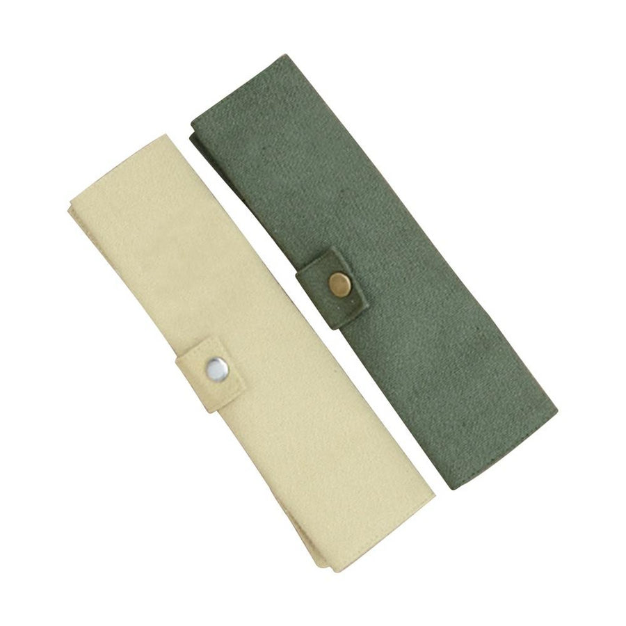 Two canvas pouches for bamboo cutlery, one green and one beige, rolled up with snap enclosures.
