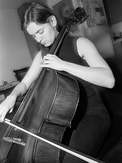 Cello Player Practicing, Black and White Photograph