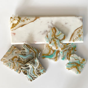 marble cheese board with golden feet