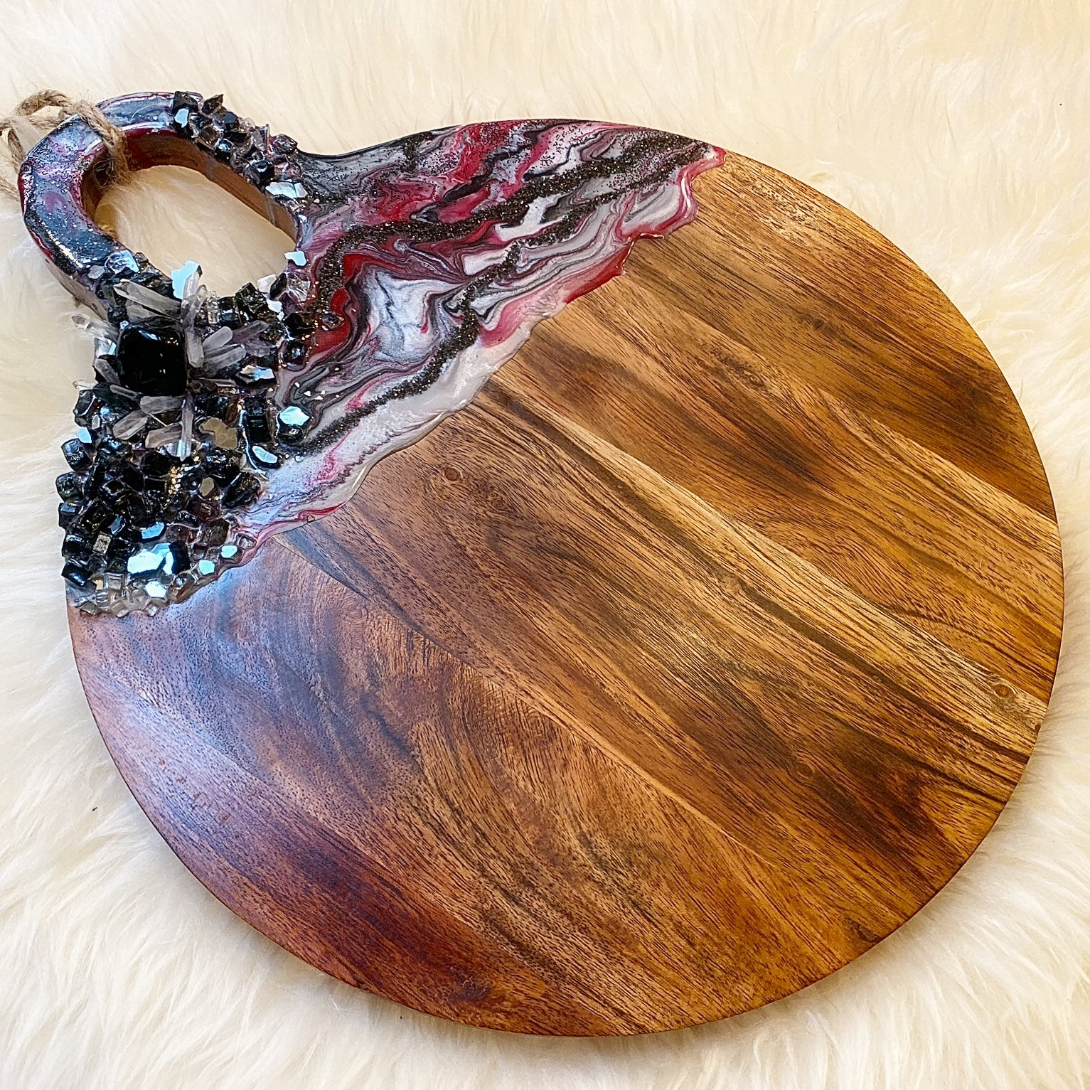 black and red round charcuterie board
