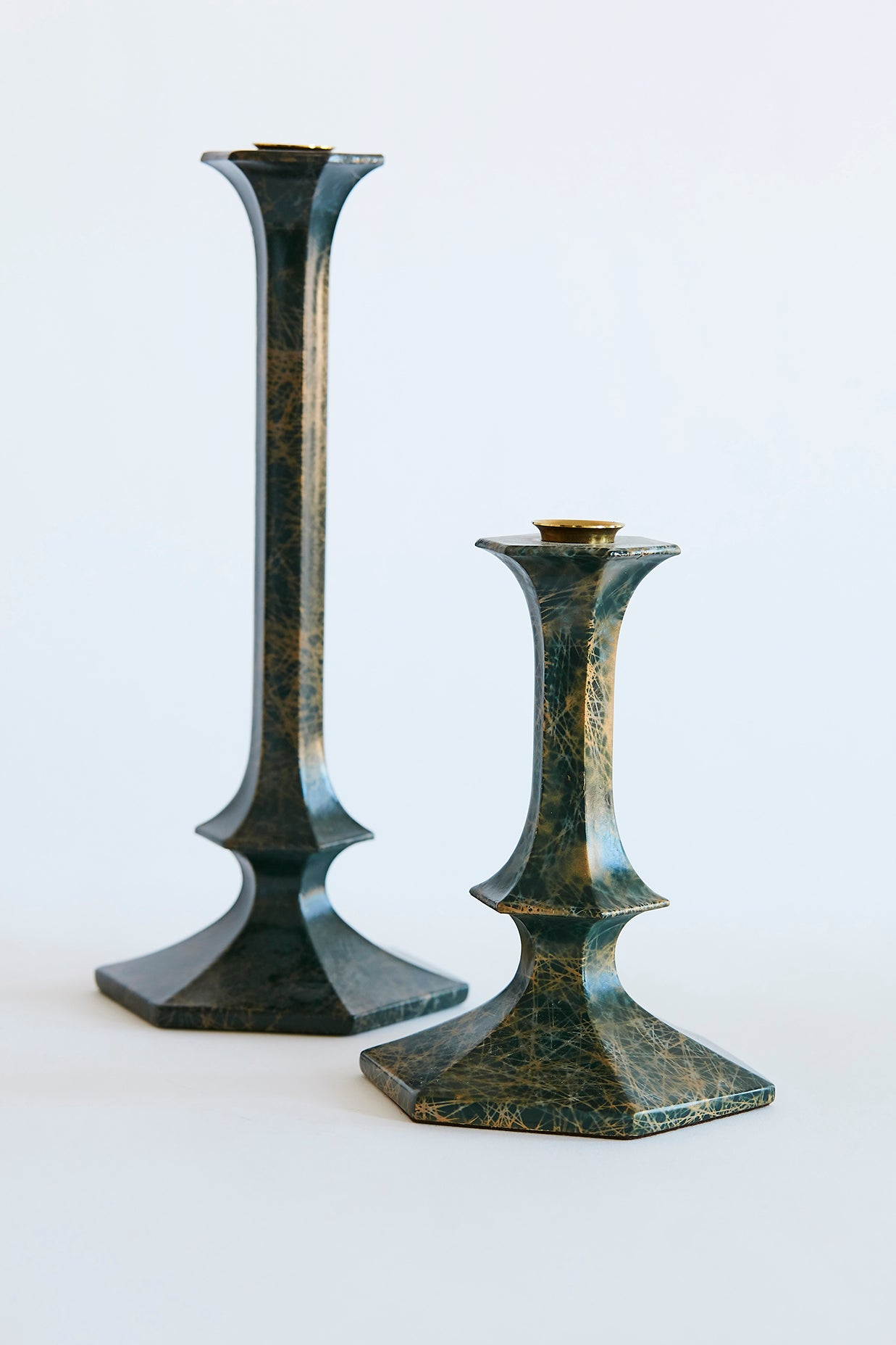 brass and lacquer candlesticks