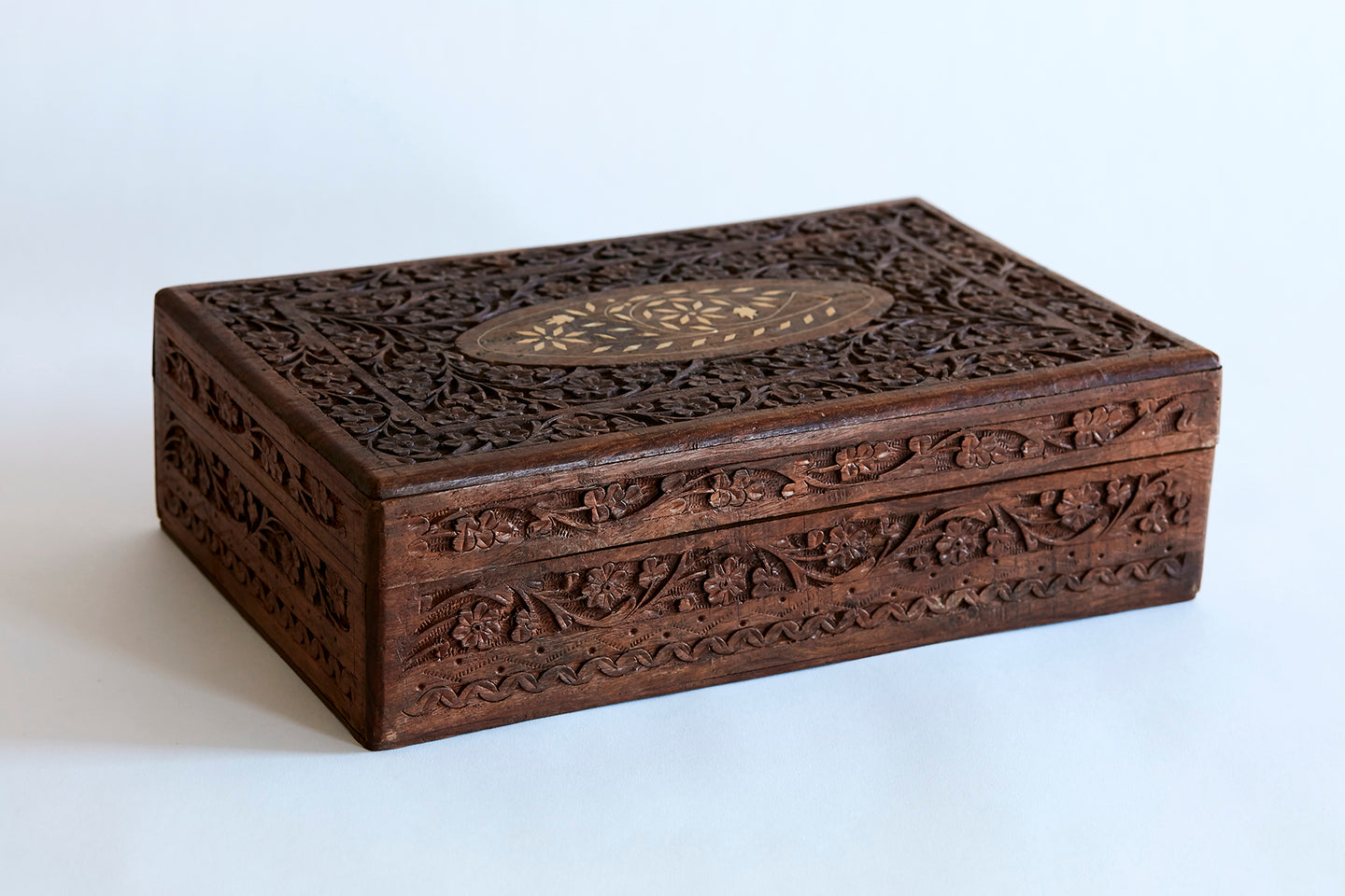 carved wood box with bone inlay detail