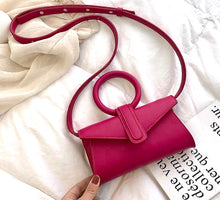 Load image into Gallery viewer, Mini vegan leather bag in fuchsia pink with circular handle and detachable strap in the same color