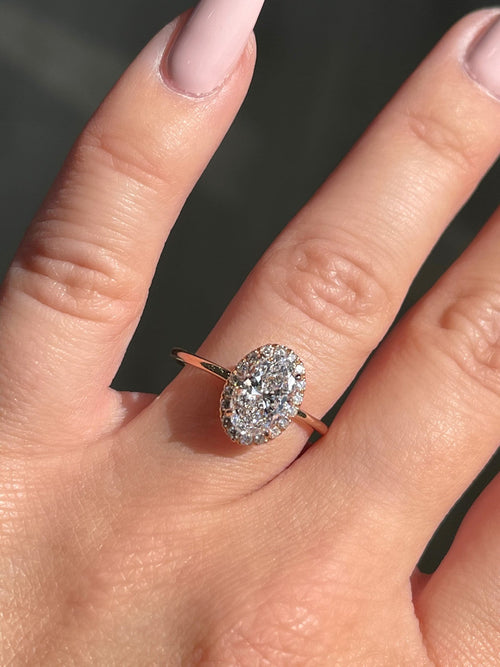 1.2 Carat Oval Diamond Engagement Ring w/ .2 Diamond Halo | 14kt Rose Gold | Engagement Ring Wednesday - Happy Jewelers Fine Jewelry Lifetime Warranty