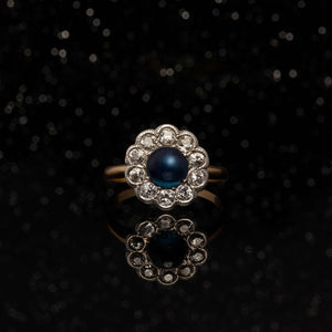 THE ANTIQUE SAPPHIRE AND DIAMOND HALO RING
