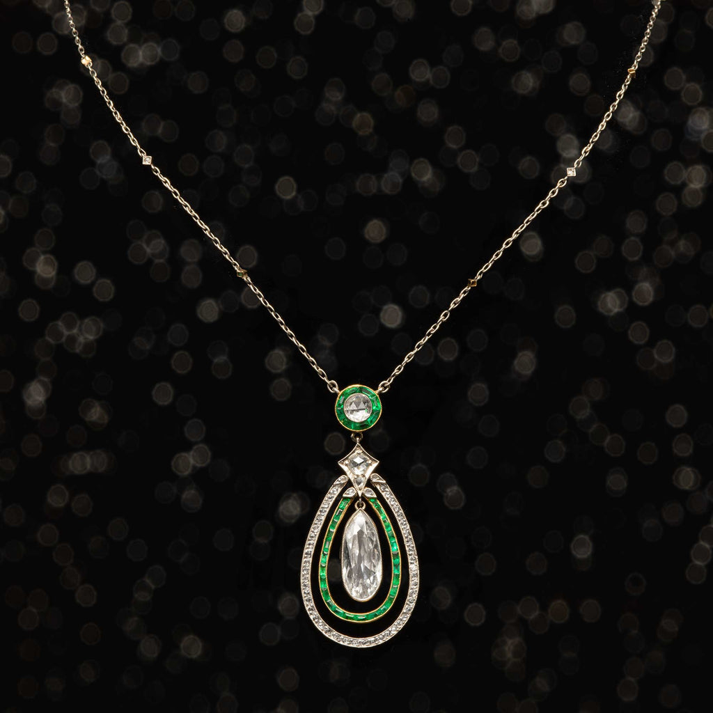 THE EDWARDIAN DIAMOND WITH EMERALD HALO PENDANT NECKLACE