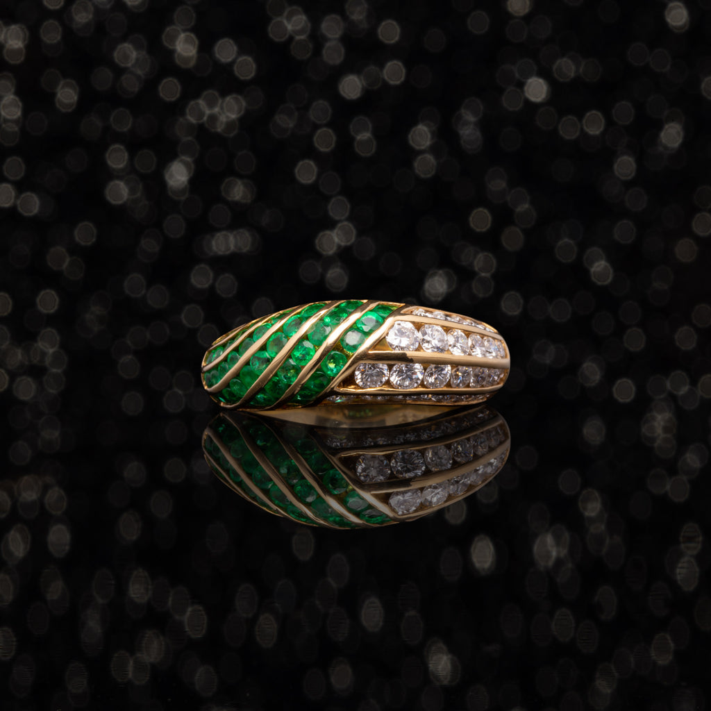 THE VINTAGE EMERALD AND DIAMOND WAVES RING