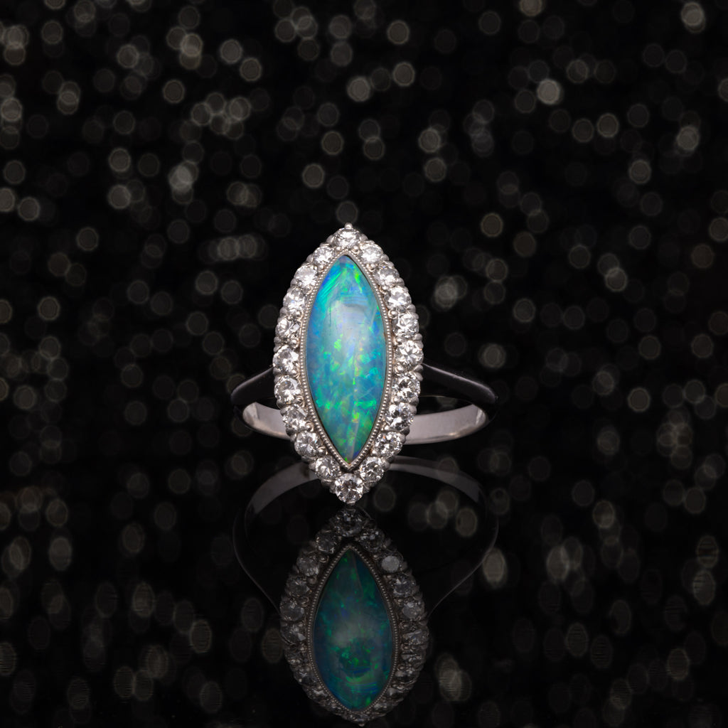 THE VINTAGE OPAL AND DIAMOND NAVETTE RING