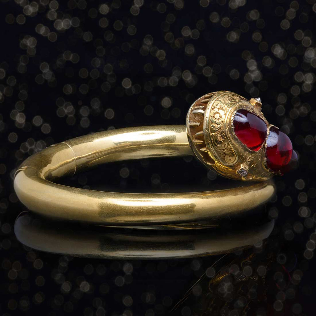 THE GOLD & GARNET SNAKE BANGLE