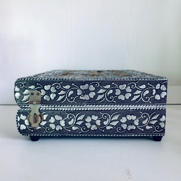 Wooden jewelry box with metal decoration