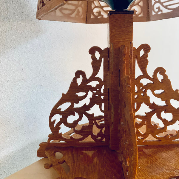 Wooden lamp with hand cut silhouettes